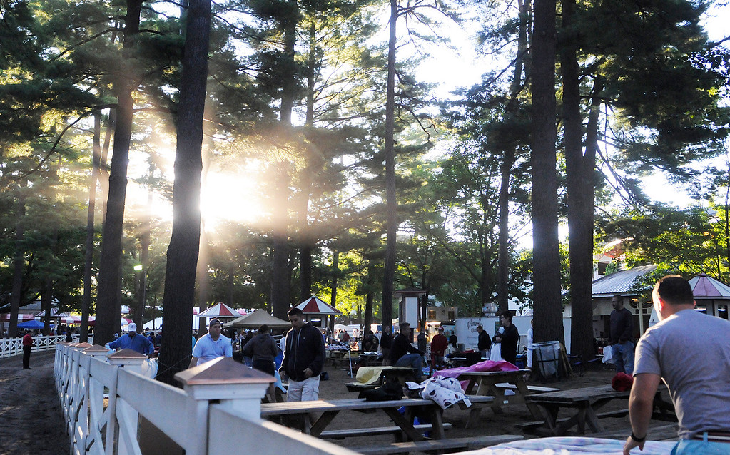 . Patrons set up their picnic areas at their perfect location for the day on the backyard at the Saratoga Race Course for The Travers on Saturday morning.Photo Erica Miller/The Saratogian 8/24/13 news_TheMadDash7