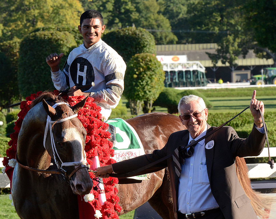 . Owner Willis Horton leads Travers winner Will Take Charge and jockey Luis Saez to the winners circle after Saturday\'s Travers Stakes. Photo Ed Burke/SARATOGIAN 8/22/13