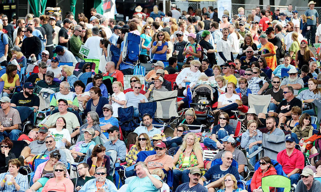 . Erica Miller - The Saratogian Huge crowds fill the lawns for the Farm Aid 2013 in Saratoga Springs on Sept. 21, 2013 at Saratoga Performing Arts Center.SAR-l-CrowdStuff4