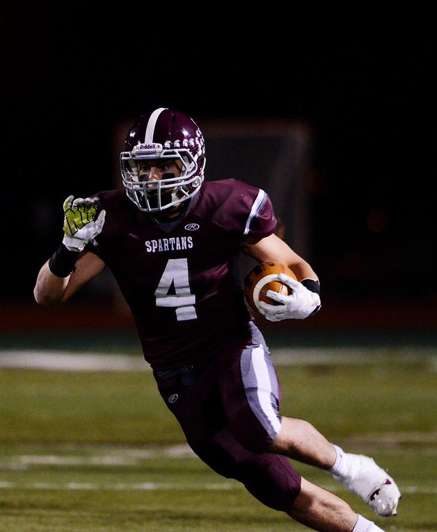. Erica Miller - The Saratogian @togianphotog      Burnt Hills-Ballston Lake\'s Daniel Porter carried the ball down the field against Queensbury\'s for the Section 2 Class A Superbowl Saturday evening Nov. 9, 2013.SAR-l-footballs2