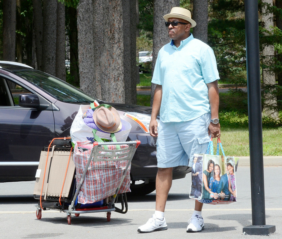 . Chris McLaurin of Poughkeepsie readies his gear to attend his first jaz festival at SPAC Saturday.