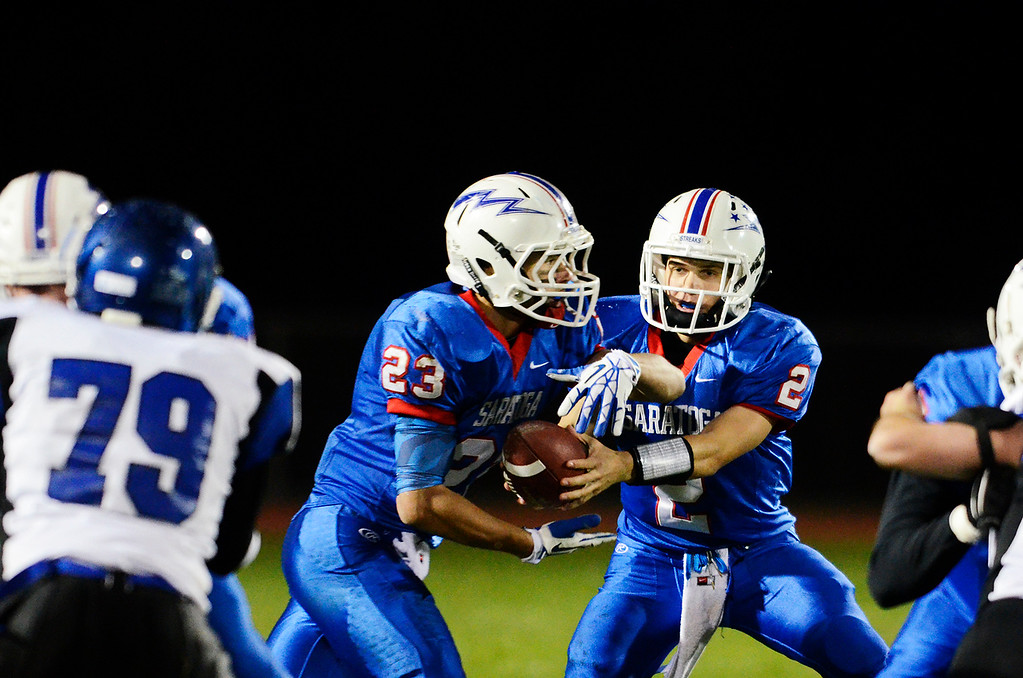 . Erica Miller - The Saratogian @togianphotog      Saratoga\'s Jake Eglintine passed the ball to Jordan Wilcox during their playoff football game against LaSalle on Friday evening under the lights in Saratoga. SAR-l-SarFootball6