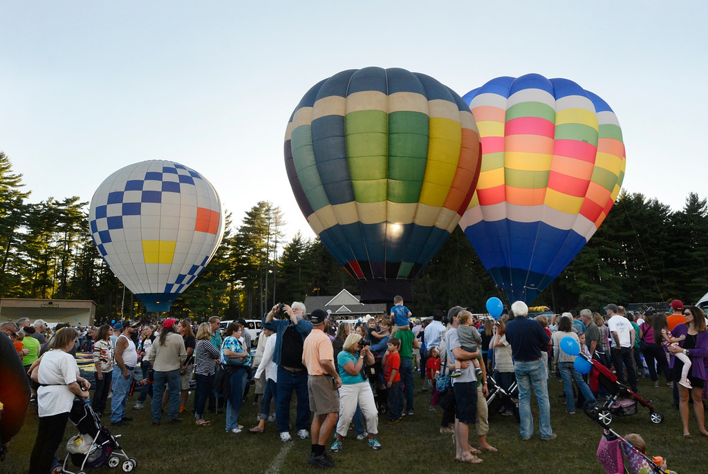 . A setting sun illuminates balloons as they lift off from Crandall Park in Glens Falls Thursday evening during the opening night of the Adirondack Hot Air Balloon Festival. Photo Ed Burke/SARATOGIAN 9/19/13