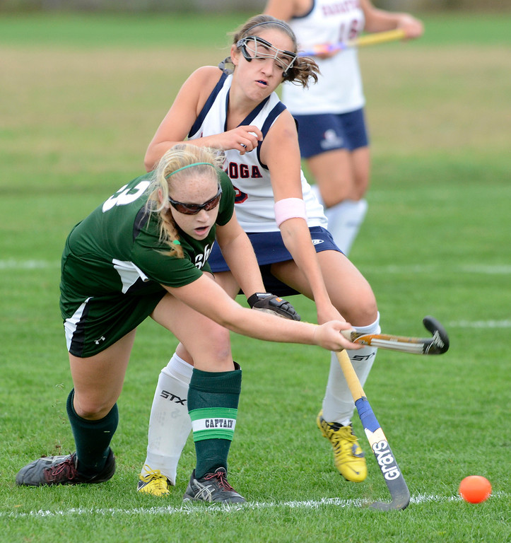 . Saratoga\'s Samantha Petruzzo vies for the ball with Shen\'s Erin Buckley during Wednesday\'s varsity field hockey game at Saratoga. Ed Burke -  The Saratogian 10/16/13