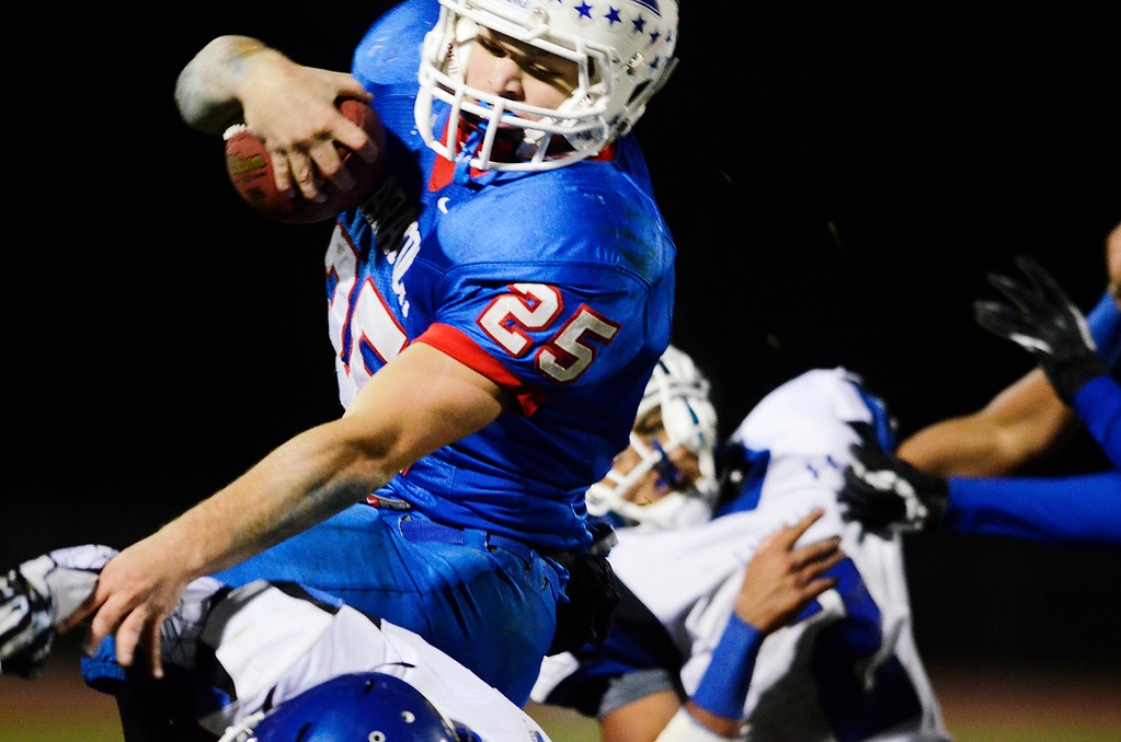 . Erica Miller - The Saratogian @togianphotog      Saratoga\'s Dakota Harvey runs down the field during their playoff football game against LaSalle on Friday evening under the lights in Saratoga. SAR-l-SarFootball13
