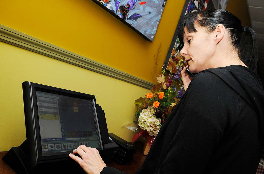 . Erica Miller - The SaratogianAugie\'s restaurant will be opening their doors Wednesday evening in their new temporary home at the former Manna\'s on Low Street in Ballston Spa. Waitress Beth Pilgram took an order on the computer from the phone. Augie\'s restaurant was burnt in this summer.SAR-l-AugieOpens2