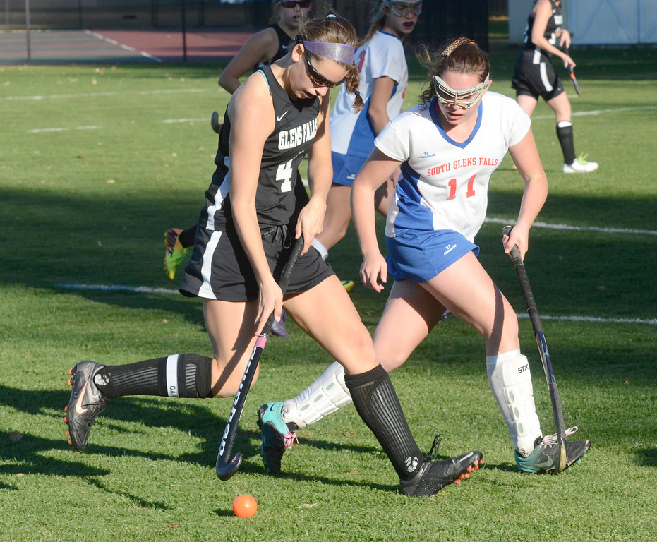 . Ed Burke - the Saratogian South High varsity field hockey player Kelsy Baldwin shadows Monica Harvey during the Bulldogs 1-0 semi-final win over Glens Falls Tuesday at South Glens Fall High School.