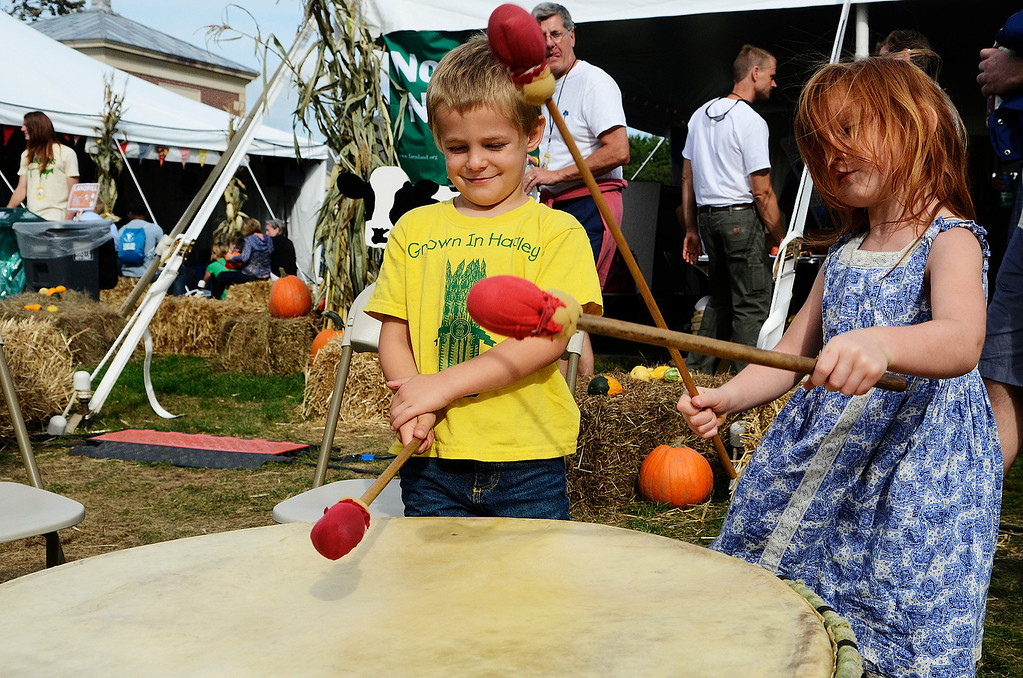 . Erica Miller - The Saratogian Corey and Sara, siblings, Stanley from Hadley Mass. bang away on a native drum at the Homegrown Tent for the Farm Aid 2013 in Saratoga Springs on Sept. 21, 2013 at Saratoga Performing Arts Center.SAR-l-CrowdStuff3