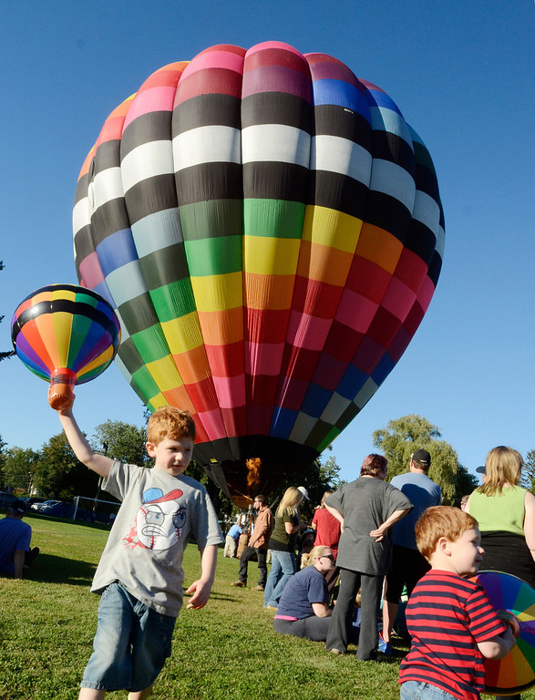 . With their balloons on display, brothers Phin, left, and Tobey Austin of South Glens Falls attend the opening day of the Adirondack Hot Air Balloon Festival Thursday evening at Crandall Park in Glens Falls. Photo Ed Burke/SARATOGIAN 9/14/13