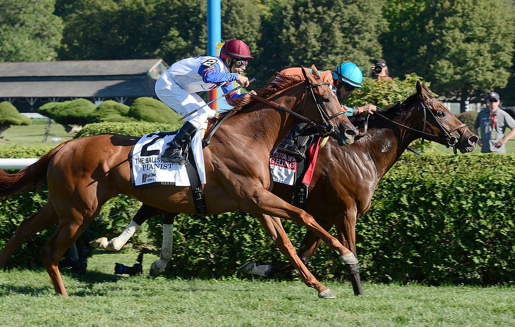 . Laughing and Jose Lezcano win a narrow victory over Pianist and Mike Smith in Saturday\'s Ballston Spa Stakes. Photo Ed Burke/Saratogian 8/24/13
