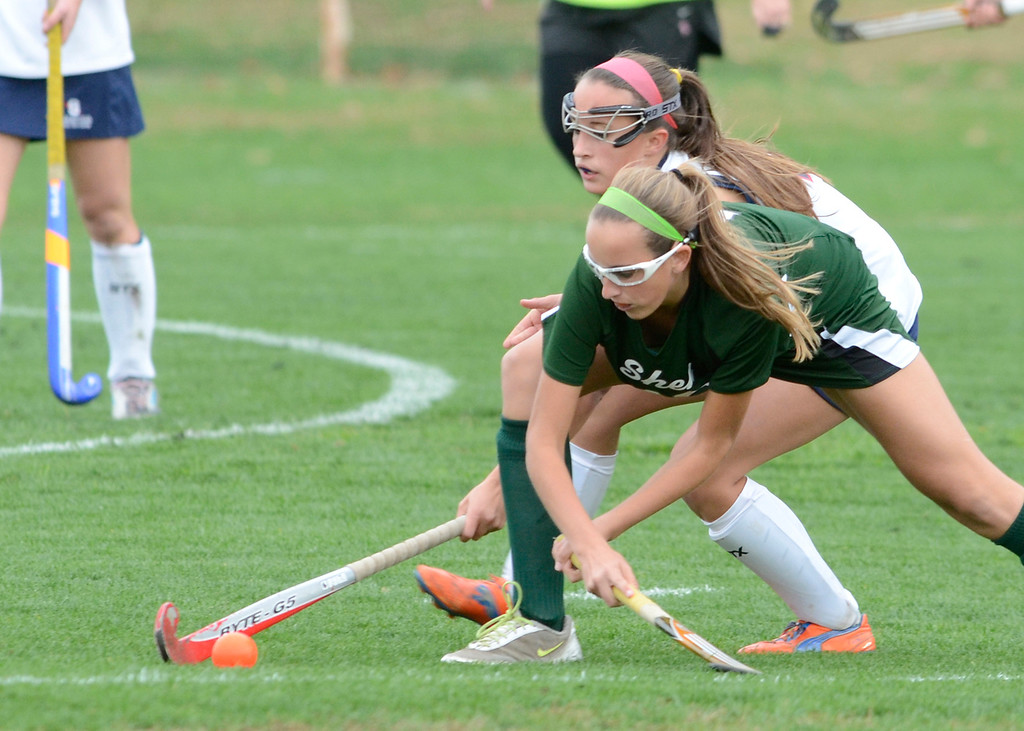 . Shen\'s Morgan Van Epps battles with Saratoga\'s Kate Dennett during Wednesday\'s varsity field hockey game at Saratoga. Ed Burke -  The Saratogian 10/16/13