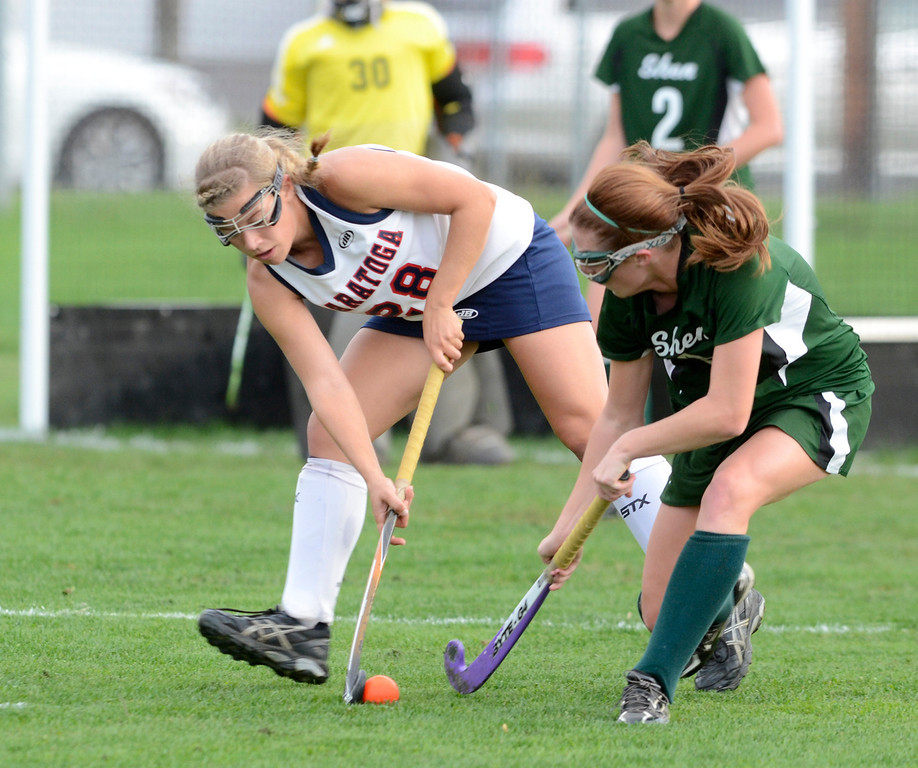 . Saratoga\'s Kelsey Briddell battles with Shen\'s Molly Hagen during Wednesday\'s varsity field hockey game at Saratoga. Ed Burke -  The Saratogian 10/16/13