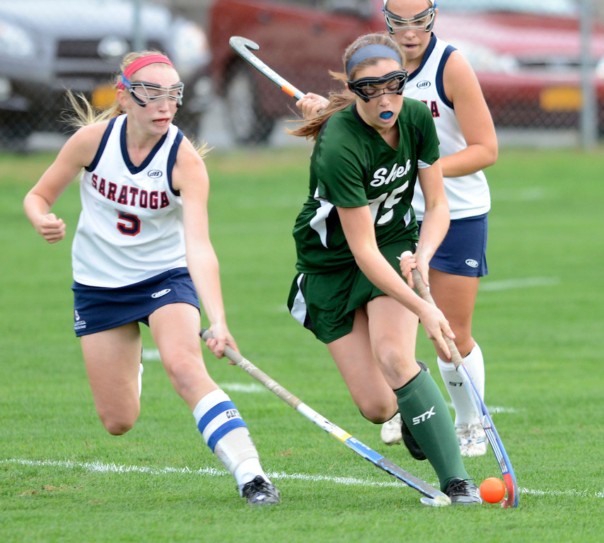 . Saratoga\'s Lindsay Rutz pressures Shen\'s Rachel Picchi during Wednesday\'s varsity field hockey game at Saratoga. Ed Burke -  The Saratogian 10/16/13