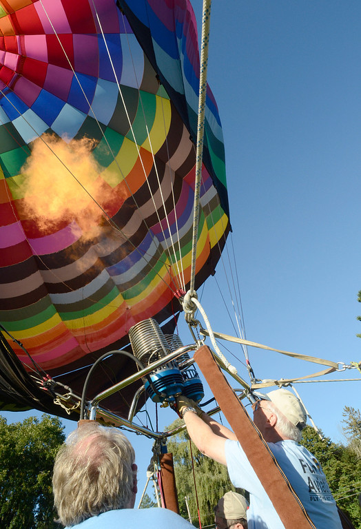 . A balloon inflates at Crandall Park in Glens Falls Thursday evening during the opening night of the Adirondack Hot Air Balloon Festival. Photo Ed Burke/SARATOGIAN 9/19/13