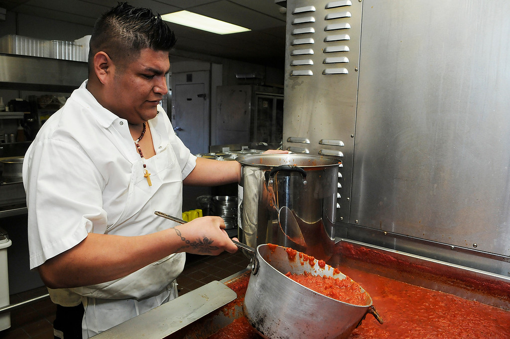 . Erica Miller - The SaratogianAugie\'s restaurant will be opening their doors Wednesday evening in their new temporary home at the former Manna\'s on Low Street in Ballston Spa. Cook Jose Cabrera dished their famous pasta sauce. Augie\'s restaurant was burnt in this summer.SAR-l-AugieOpens4