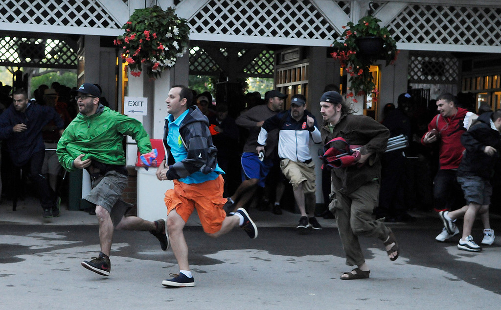 . The mad dash into the entrance gates to find their perfect location into the Saratoga Race Course for The Travers on Saturday morning.Photo Erica Miller/The Saratogian 8/24/13 news_TheMadDash5