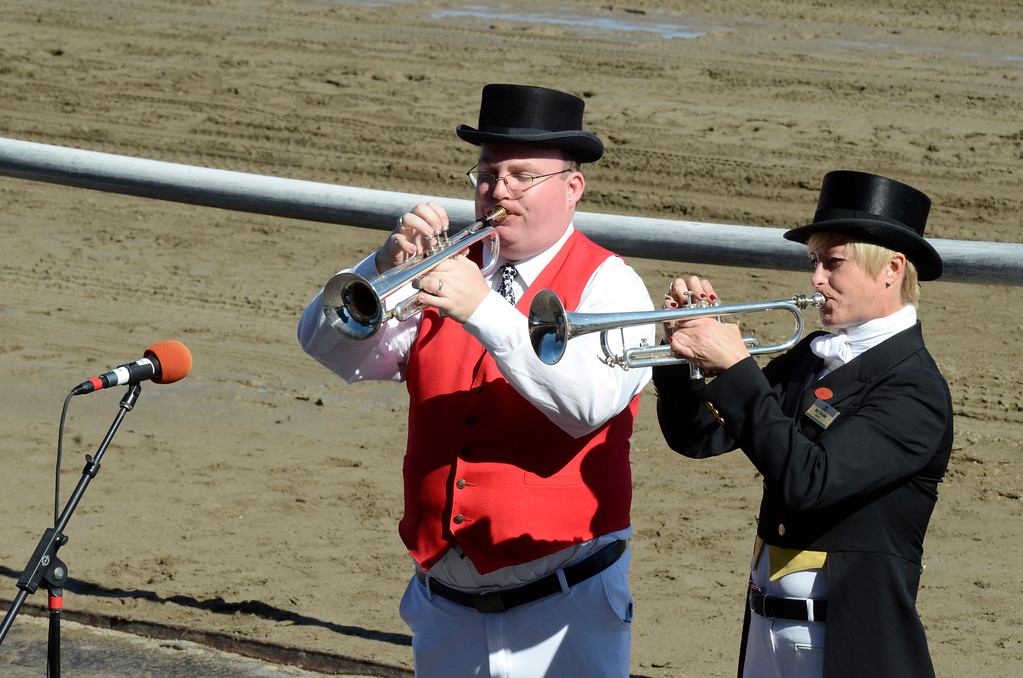 . Buglers Ryan Resky and Bethann Dixon play the call to the post before Saturday\'s Test Stakes. Photo Ed Burke/SARATOGIAN 8/24/13